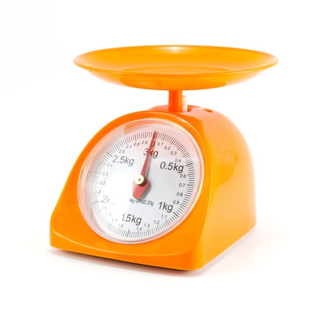 weigh machine: orange steelyard isolated on white background Stock Photo