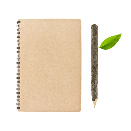 notebook and wooden pencil isolated on white background, conservation concept Stock Photo