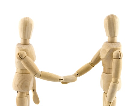 wood figurine: Wooden dummies shaking hands, Cooperation of business
