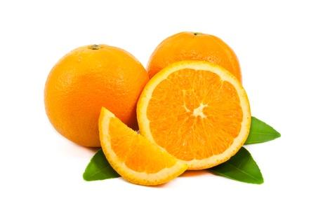 Slice of orange with green leaf isolated on white background