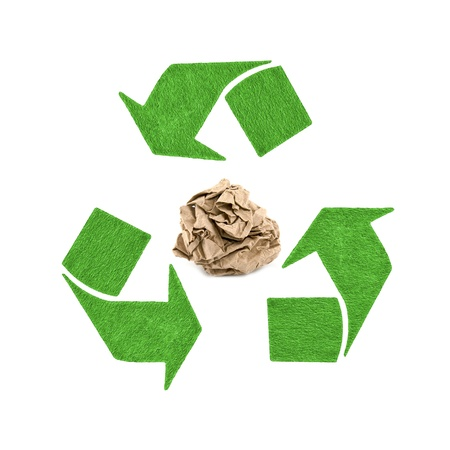 crumpled paper with recycling symbol on white background photo