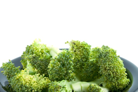 raw broccoli isolated on white background photo