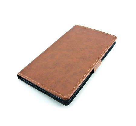 single leather notebook isolated on white background photo