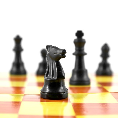 black knight on chess board isolated on white background photo