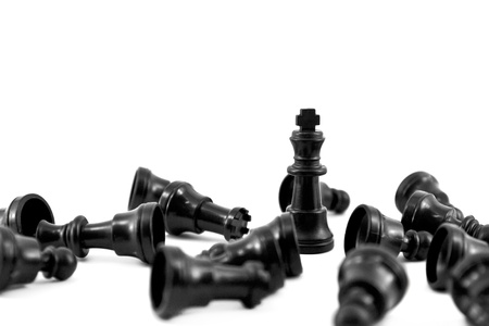 offense: Black chess king, the most of strength isolated on white background