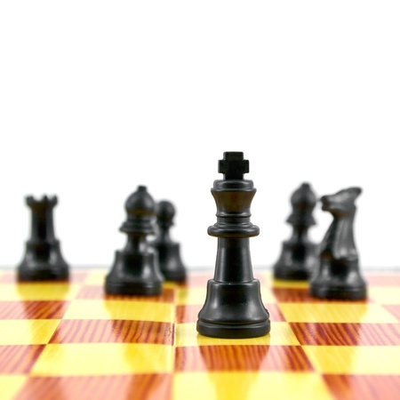 gamesmanship: Black chess king, the leader of army isolated on white background