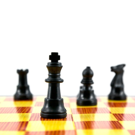 gamesmanship: the chess king, the leader of army isolated on white background,