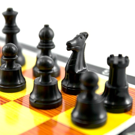 attacker: the chess knight, the good attacker of army isolated on white background, Stock Photo