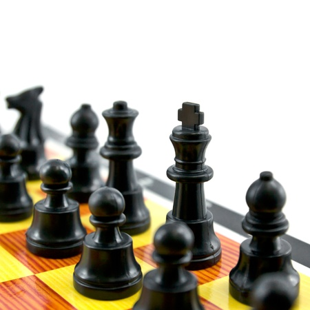 gamesmanship: the chess king and army isolated on white background Stock Photo