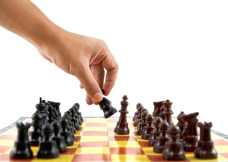 fighting between brown and black army on chess board photo