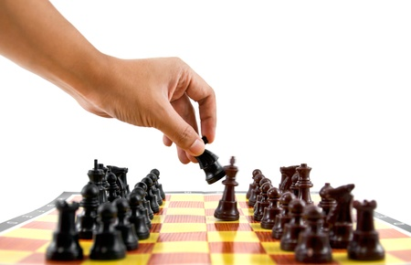 outwit: fighting between brown and black army on chess board
