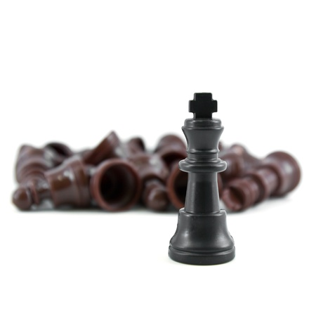 gamesmanship: Black chess king, the most of strength isolated on white background