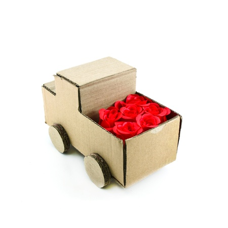 truck model made from Corrugated paper and red rose isolated on white background photo