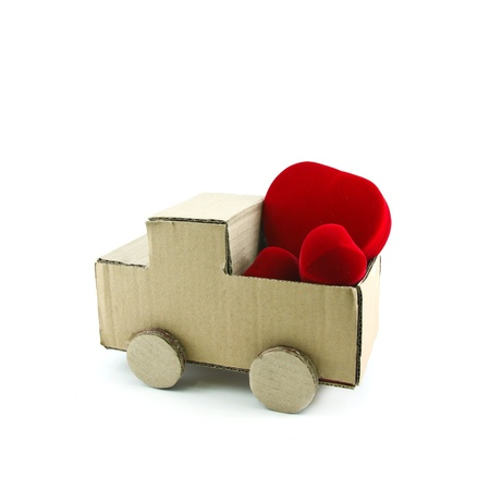 truck model made from Corrugated paper with red heart isolated on white background photo