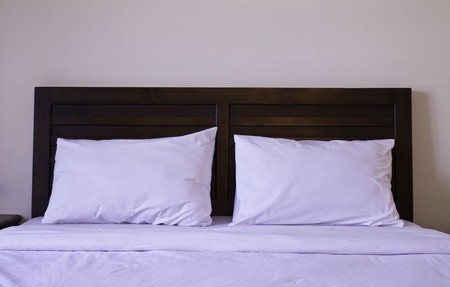 bedcover: Pillows on bed in bedroom