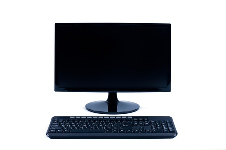 black LCD monitor and keyboard isolated on white background photo