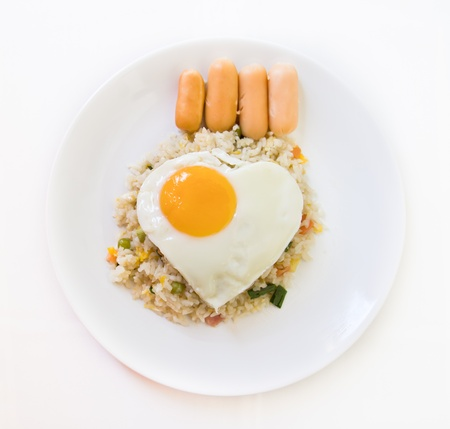 breakfast set, fried rice  with hot dog, fried egg photo