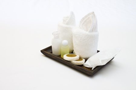 hotel bathroom: hotel amenities kit on wooden tray Stock Photo
