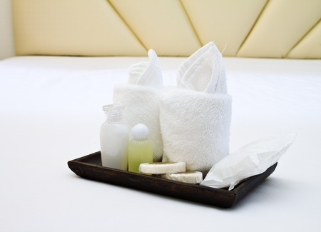 toiletries: hotel amenities kit on wooden tray Stock Photo