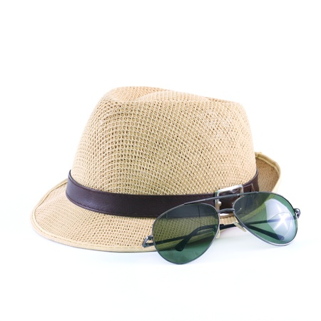 hat and sunglasses isolated on a white background photo