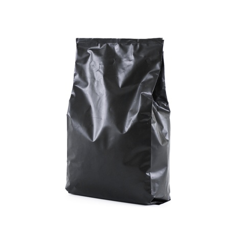 black foil bag pack isolated on white background photo