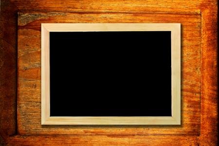 chalkboard on grunge wooden background photo