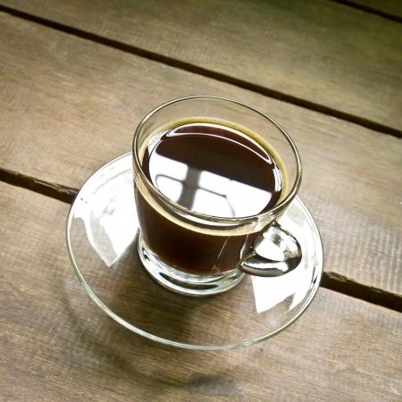 americano: coffee americano in a glass on wood