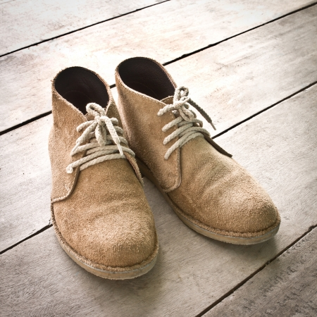 men s boot: brown boots on wood Stock Photo
