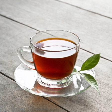 a cup of tea on wood board, drink for health