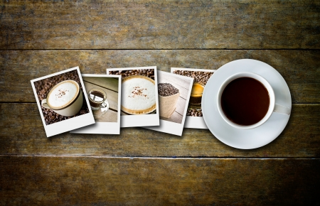coffee in  film and coffee cup on wood board photo