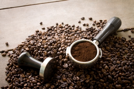 tamper: coffee filter and tamper on coffee beans