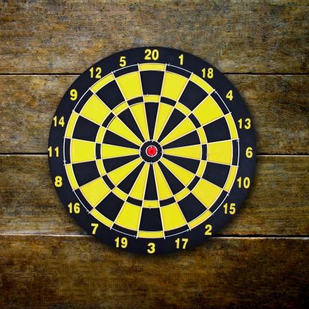 dart board: dart board on classical wood wall Stock Photo
