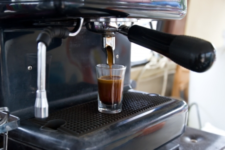 espresso machine: Espresso machine brewing a coffee