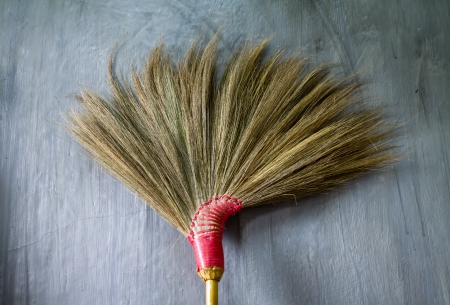 brushwood: Old broom or besom on the gray wall Stock Photo