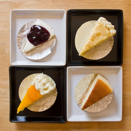blueberry pie: Butter cake, coconut pie, Orange cake, blueberry pie on plate Stock Photo