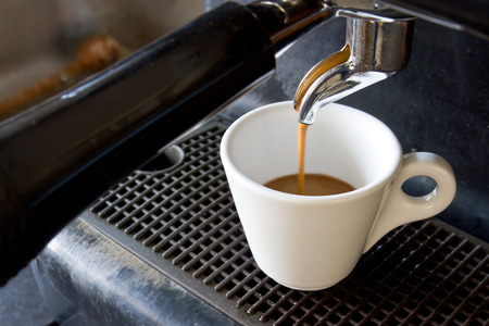 with coffee maker: Espresso machine brewing a coffee