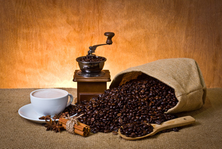 set of coffee, cup of coffee, cinnamon, star anise and coffee grinder photo