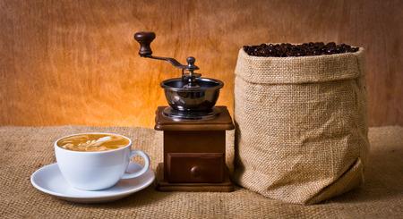 handle bars: set of coffee, latte, grinder, coffee beans in burlap Stock Photo