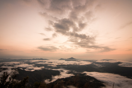 faintly visible: daybreak scene with mountain and cloudy at Pha Tang Chiangrai Thailand