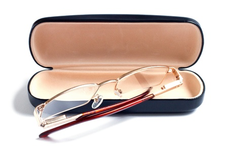 glasses of gold color and case to them photo