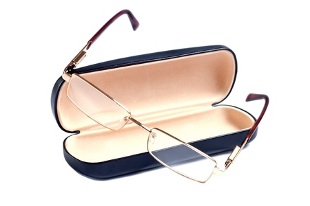 attentiveness: glasses of gold color and case to them Stock Photo
