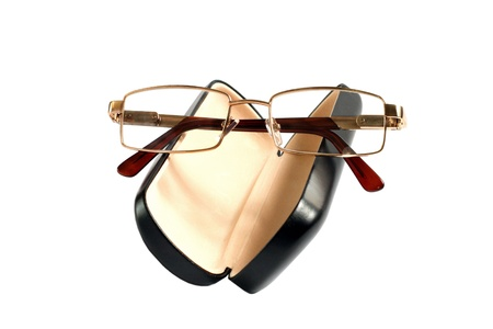 protecting spectacles: a glasses of gold color and case to them
