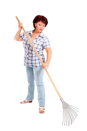 industrious: image of woman farmer with rakes in hands Stock Photo