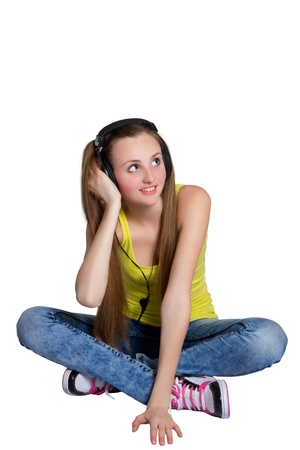 girl in headphones listens to music and laughs photo