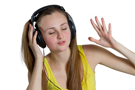girl in headphones listens to music photo