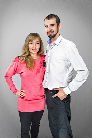 Young embracing couple in love posing at studio photo