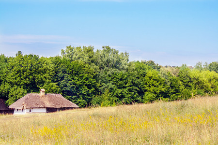 thatched: a landscape clay and wooden hut thatched Ukrainian Stock Photo