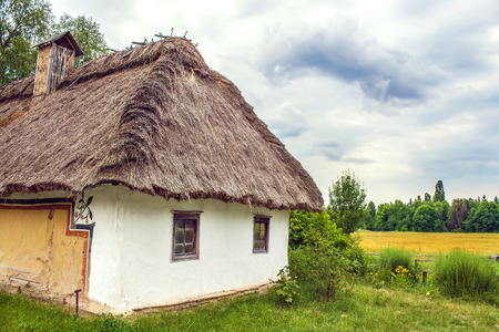 thatched: Image Ukrainian hut thatched sloping field near Editorial