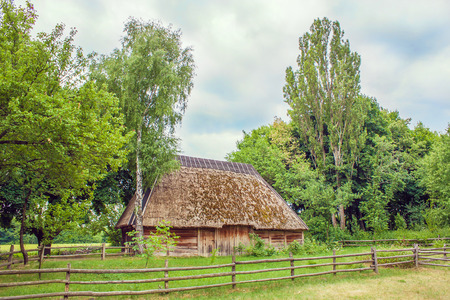 thatched: Image Ukrainian hut thatched sloping field near Stock Photo