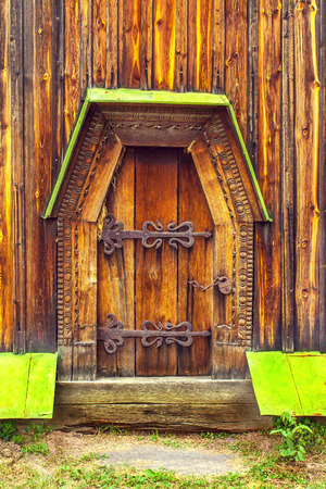 medieval blacksmith: a antique wooden doors on forged curtains locked